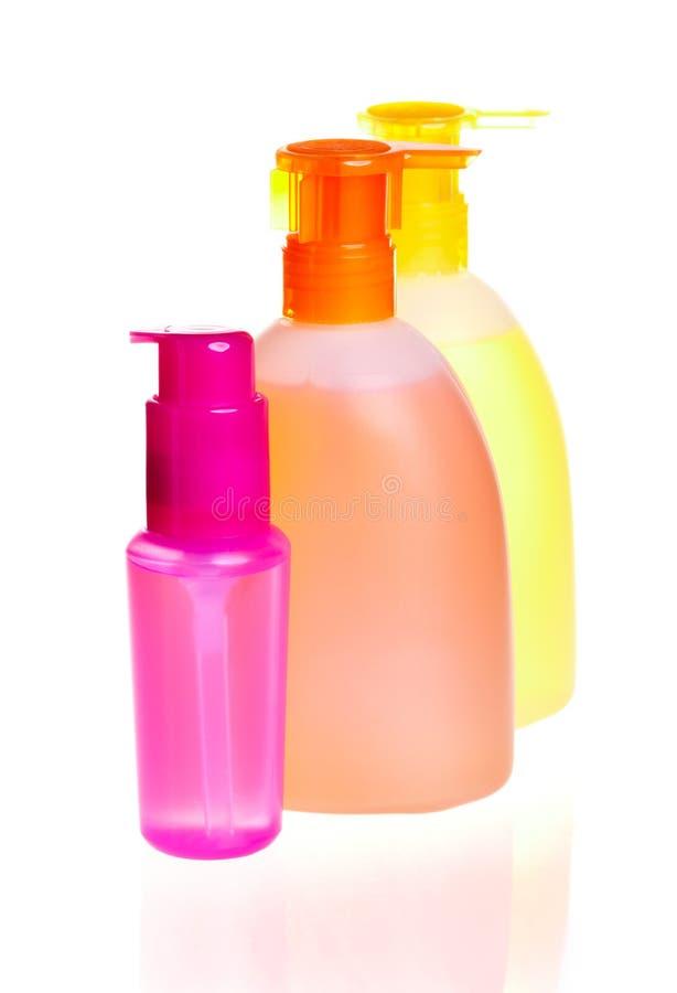 Flessen voor schoonheidsmiddelen royalty-vrije stock afbeeldingen