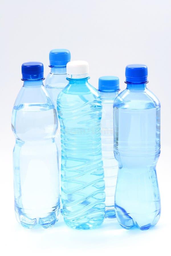 Flessen water stock afbeeldingen