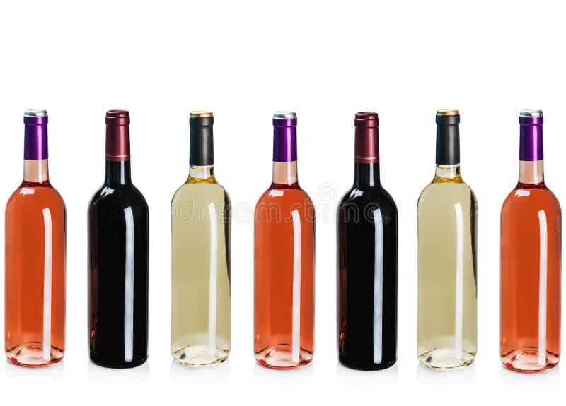 Flessen wijn van verschillende types stock foto's