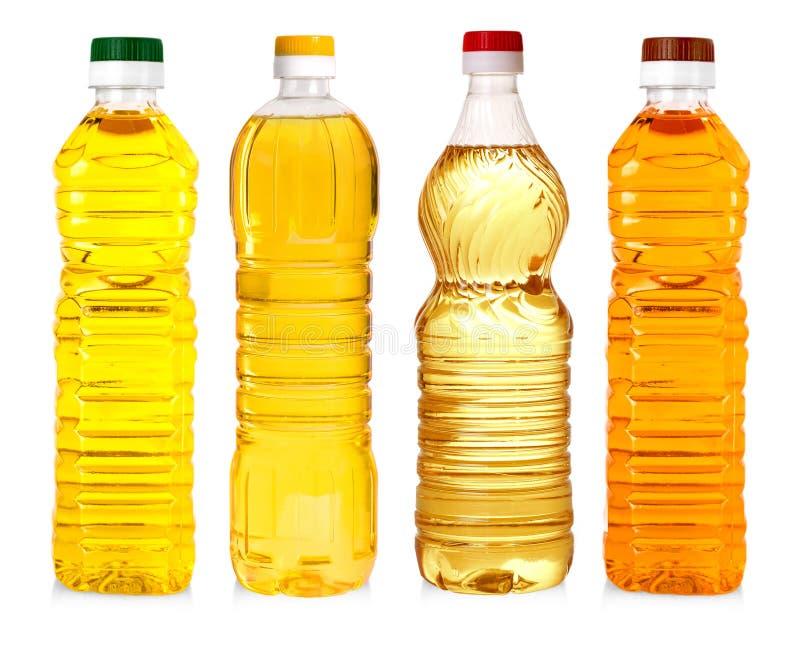 Flessen zonnebloemolie op witte achtergrond wordt geïsoleerd die royalty-vrije stock afbeeldingen