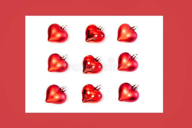 Fletley de decorações vermelhas do Natal dos corações imagens de stock royalty free