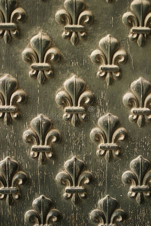 Fleur de Lis Pattern On Door. Details from the doors to Napoleon's Tomb in Paris show off a fleur-de-lis pattern that is repeated over the door. The paint is stock photo