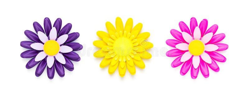 Fleur en plastique sur le fond d'isolement par blanc images libres de droits