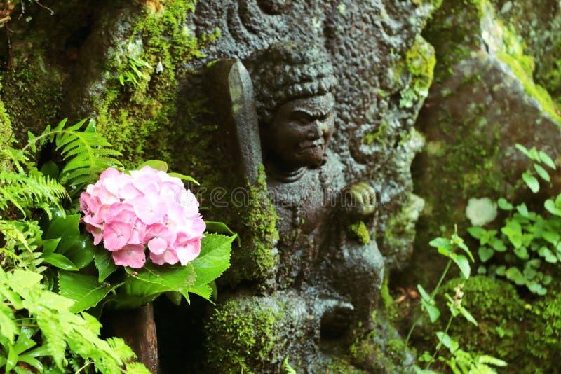 Fleur et Bouddha photo libre de droits