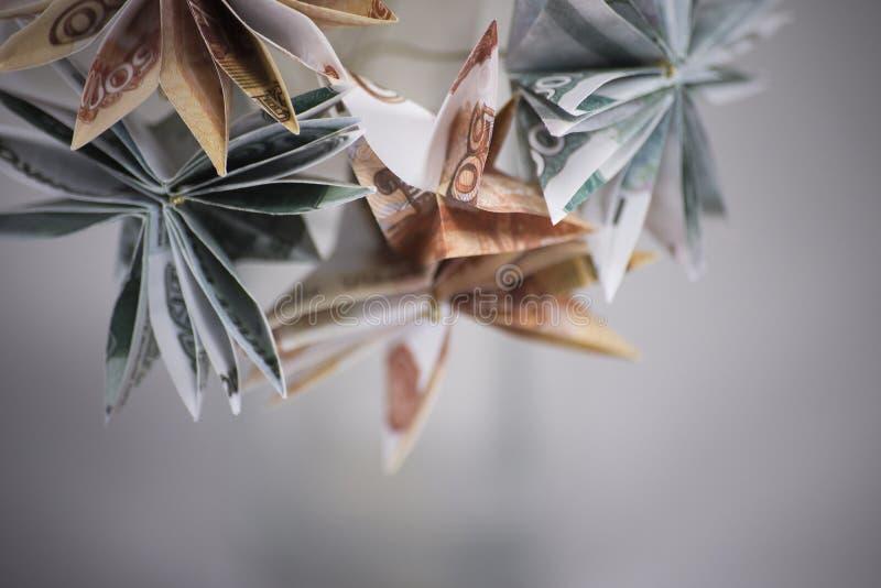 Fleurit des billets de banque d'origami images stock