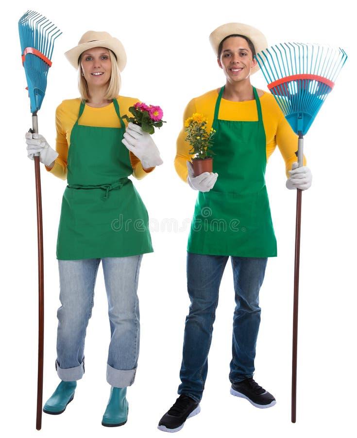Fleurs d'équipe de gardner de jardinier les jeunes ratissent l'occupa de jardinage de jardin photo stock