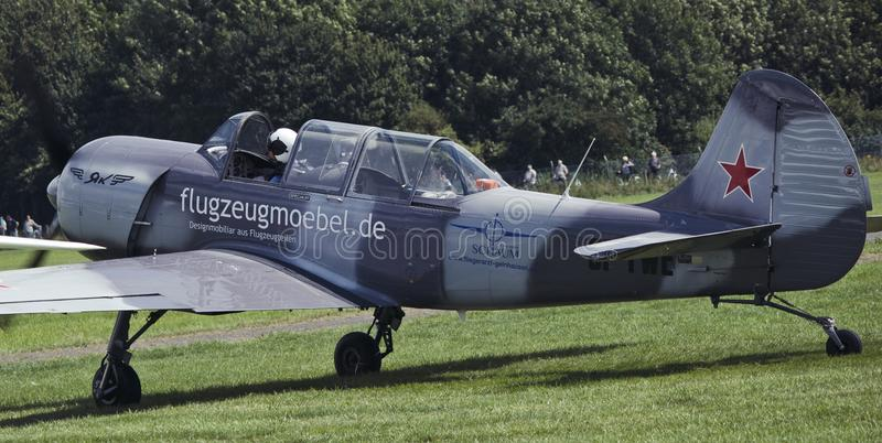 And flew. A walk on the plane, a spinning propeller. Aircraft engine. The old Soviet plane, and again take off. air show in germany stock photo