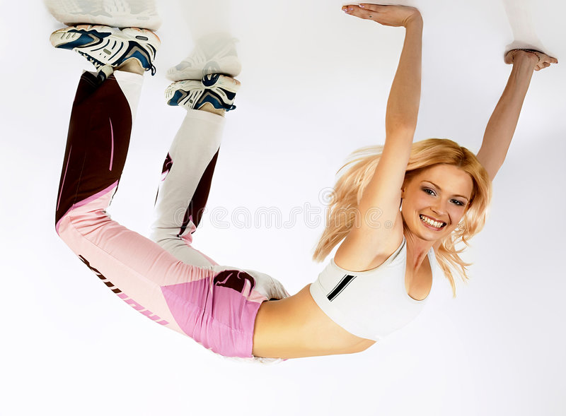 Flexibility exercise under ceiling. stock photos