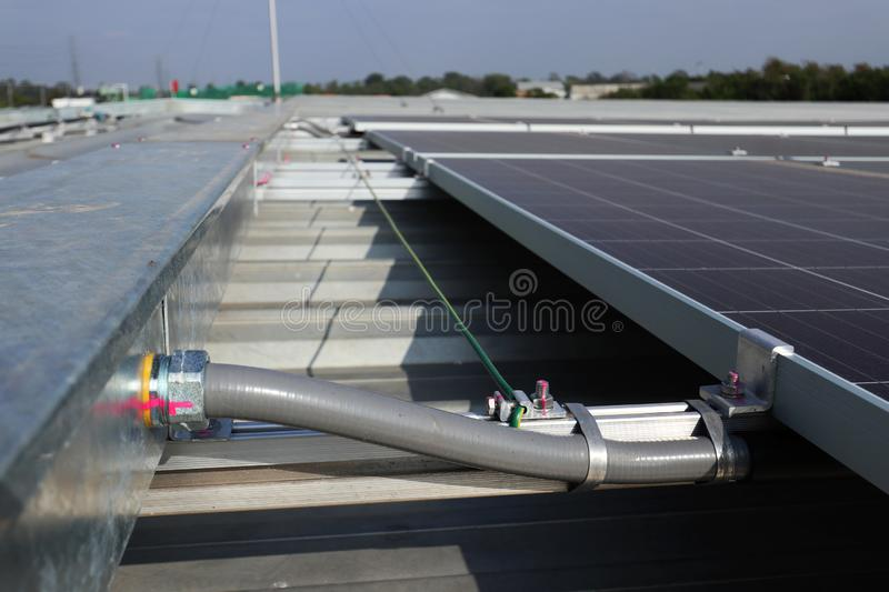 Flexible Conduit connected to Wireway Solar PV Rooftop royalty free stock images