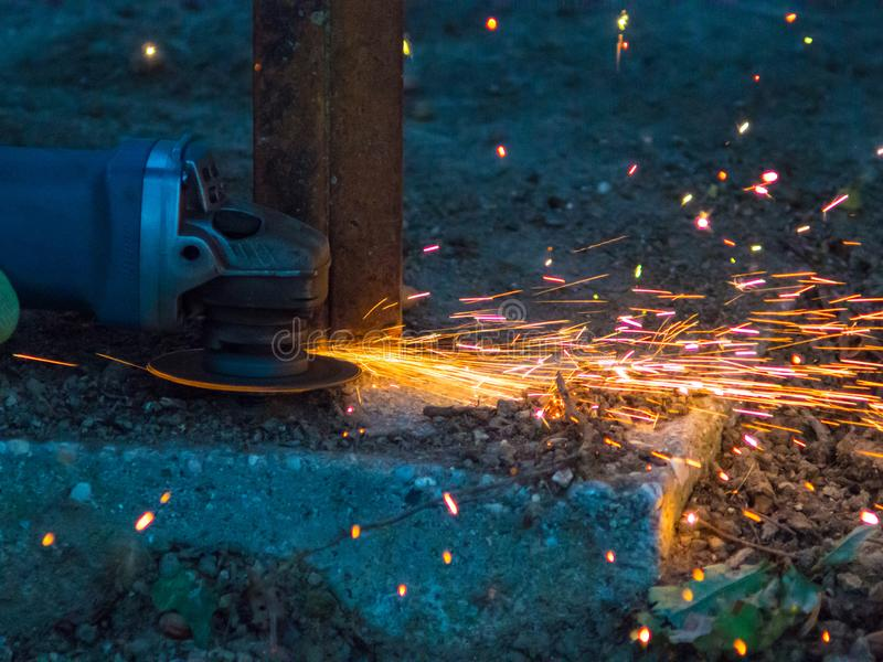 Flexible cutting a pipe. With many sparks stock photography