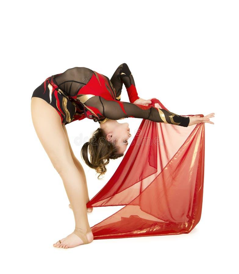 Flexible equilibrist performs exercises on acrobatic walking sticks. Studio photo on white background, isolated image royalty free stock images