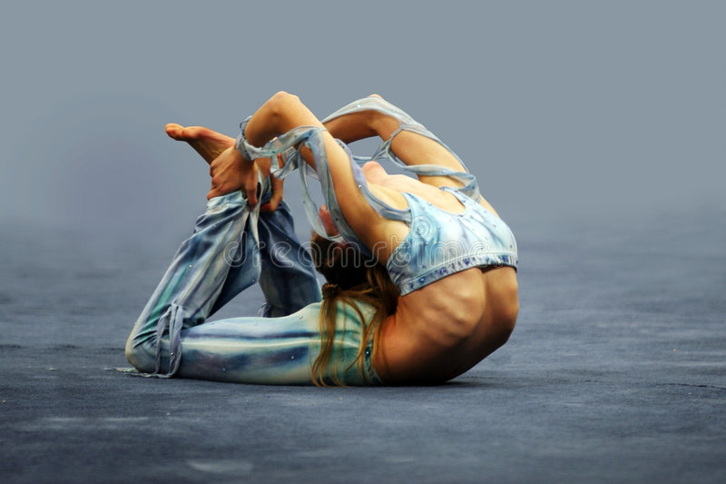 Flexible girl. Contortionist girl stock photo