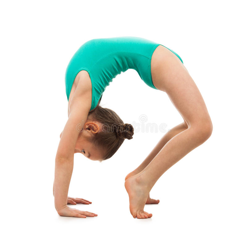 Flexible little girl gymnast doing a bridge on white background royalty free stock photography