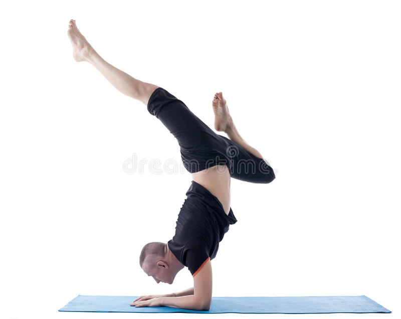Flexible Man Posing In Difficult Yoga Pose Stock