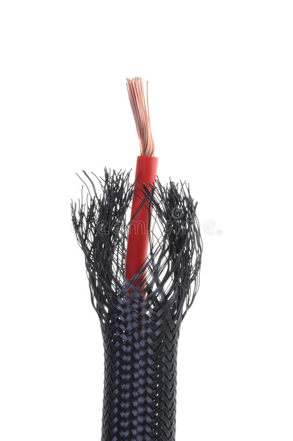 Flexible protective tube with red wire stock photography