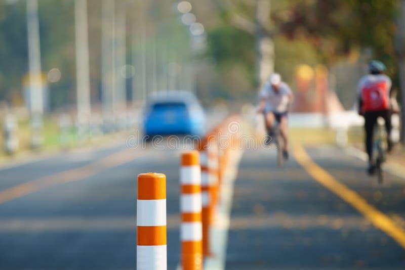 Flexible traffic bollard for bike lane. stock photo