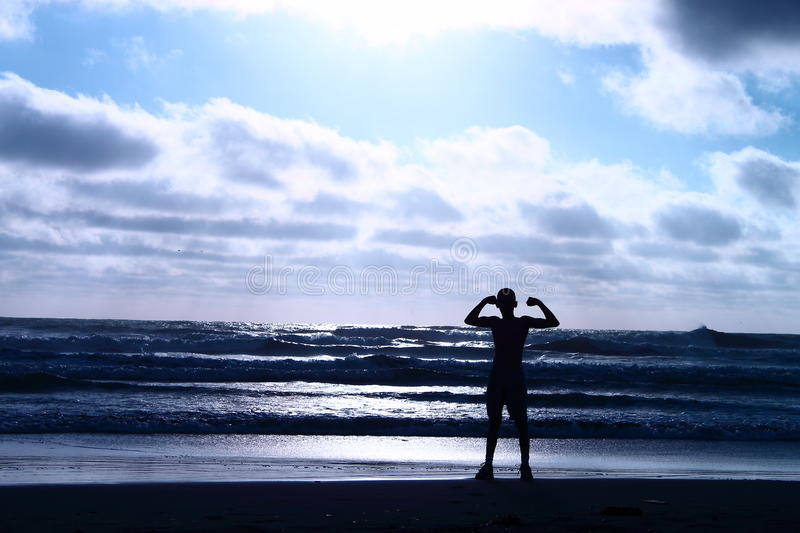 Flexing at the Beach royalty free stock photo