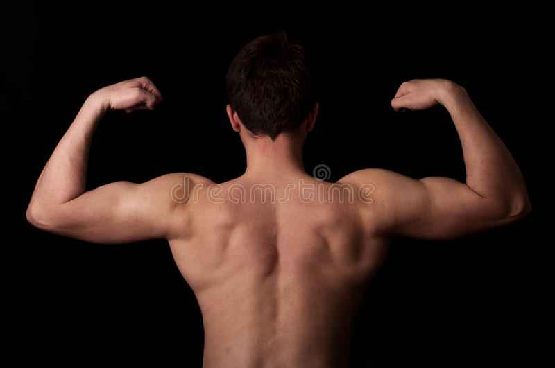 Flexing muscles royalty free stock photography
