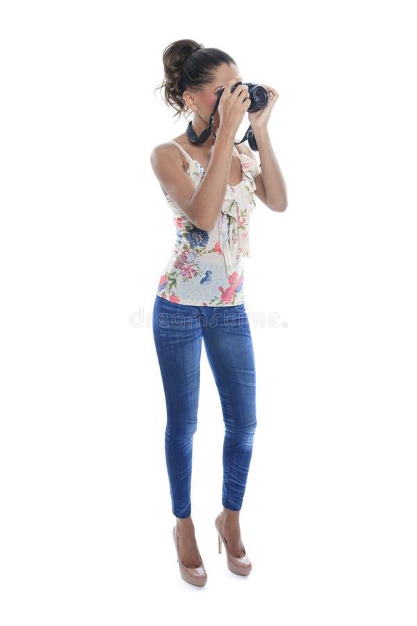 Flicka-fotograf tagandeknäpp som isoleras på vit arkivfoto