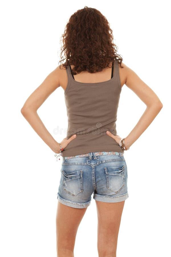 Flicka från backen i jeanskortslutningar royaltyfria foton