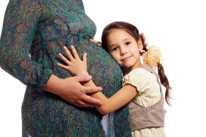 flicka hans gravida moder fotografering för bildbyråer