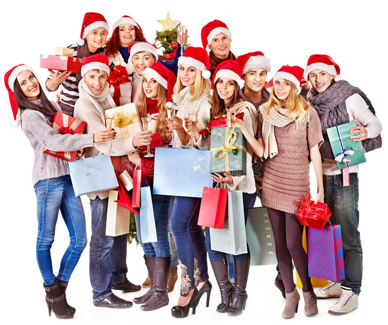 Flicka i ask för gåva för jul för jultomtenhatt hållande. arkivbilder