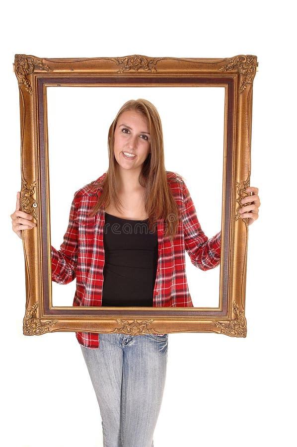 Flicka i bildram. arkivbilder