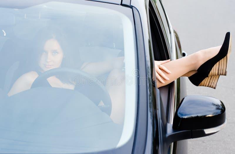 Flicka i bilen royaltyfria foton