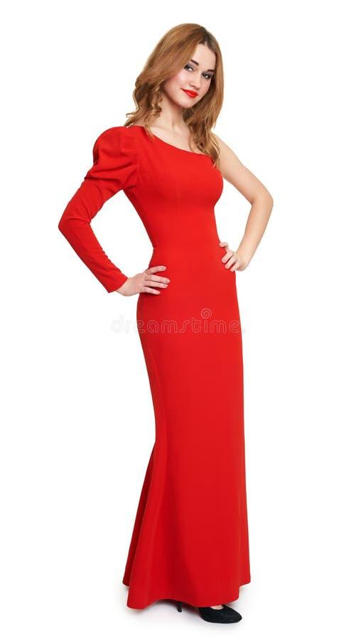 Flicka i den röda klänningen, vit bakgrund royaltyfri foto