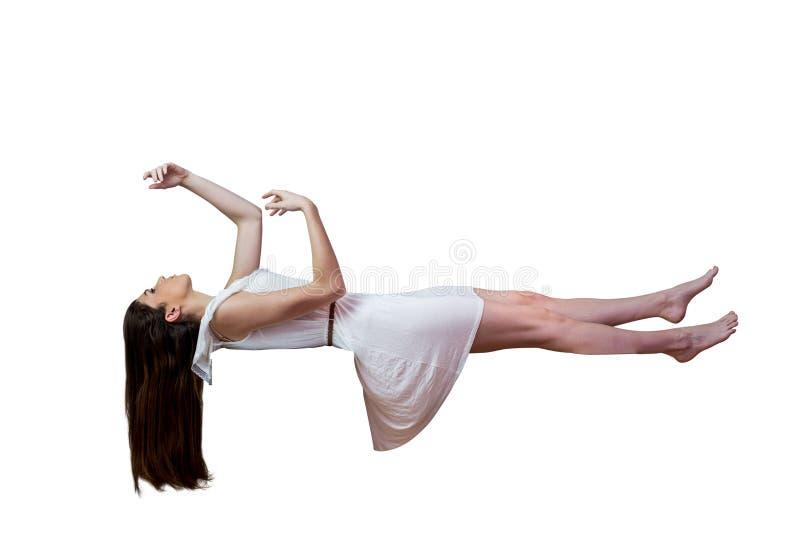 Flicka i den vita klänningen som svävar i luft arkivfoto