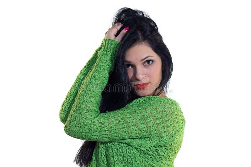 Flicka i grön tröja arkivfoton