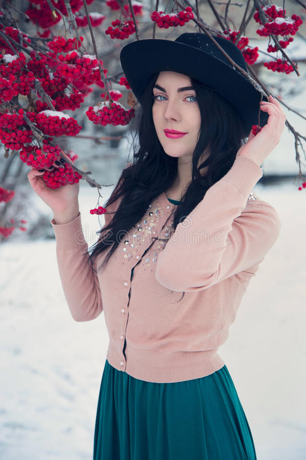 Flicka i hatt royaltyfri foto