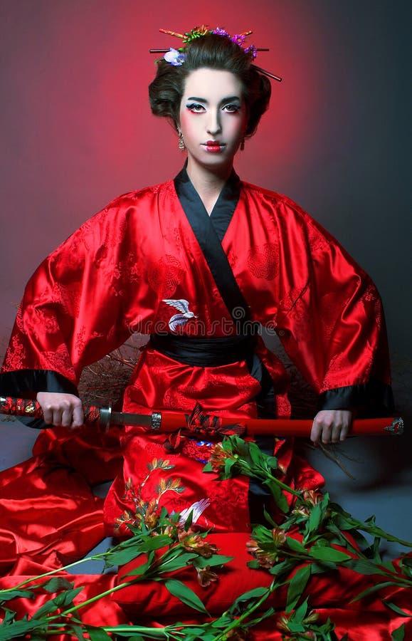 Flicka i japanisestil arkivbild