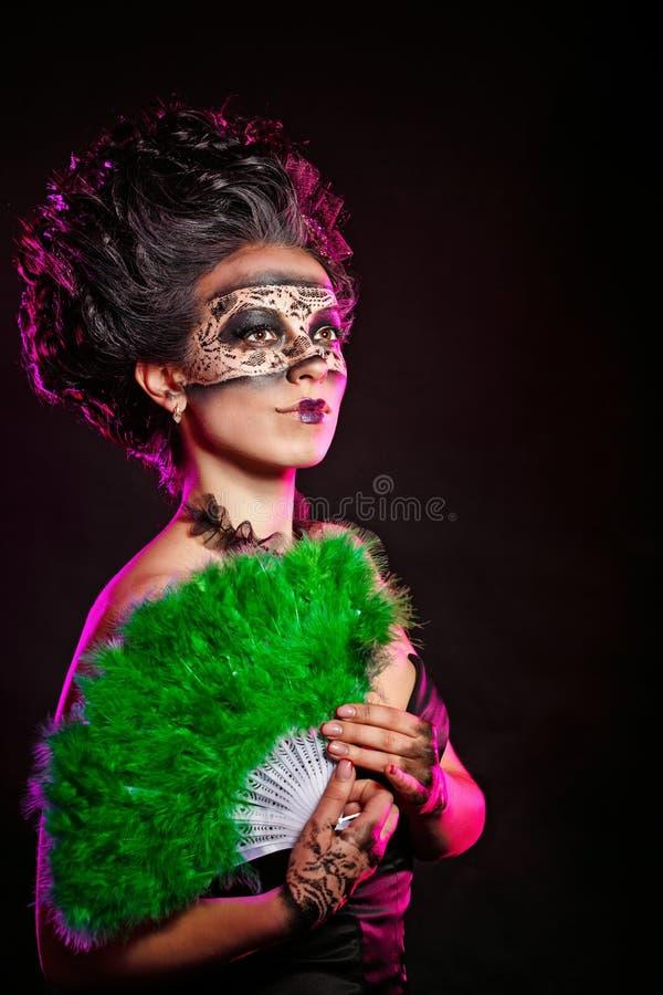 Flicka i maskeradmaskering fotografering för bildbyråer