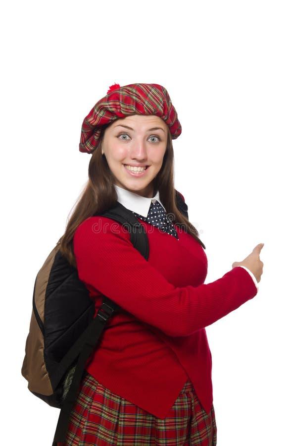 Flicka i skotska tartankläder som isoleras på vit royaltyfri fotografi
