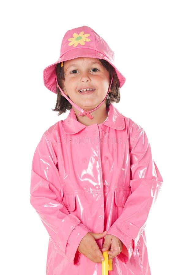 flicka little raincoat royaltyfria bilder