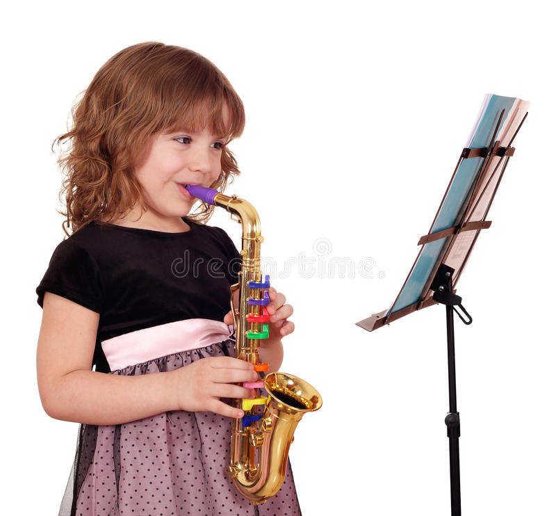 flicka little saxofon royaltyfri fotografi
