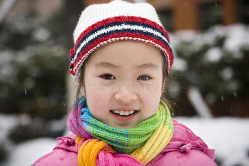 flicka little snow royaltyfri foto