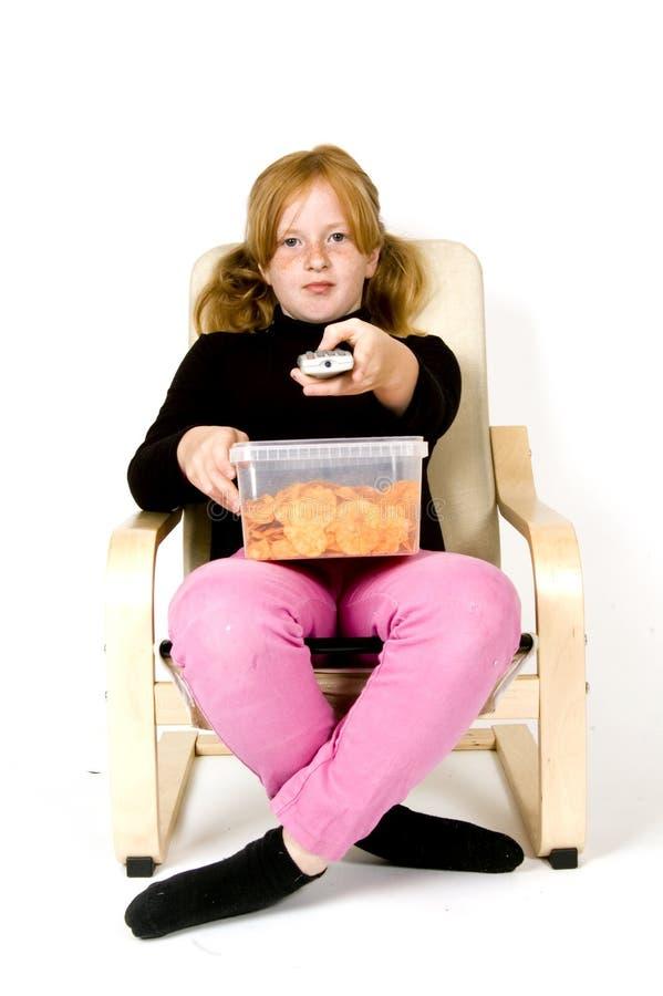 flicka little som zapping fotografering för bildbyråer