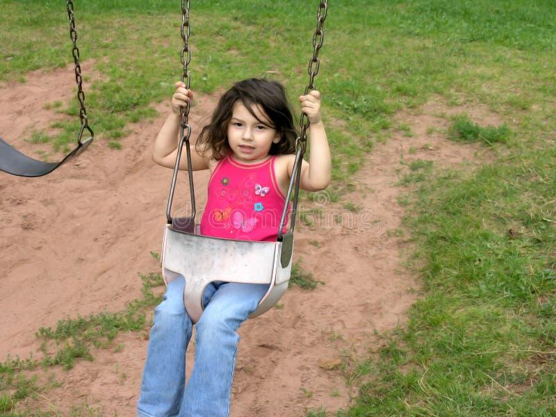 flicka little swing arkivfoton