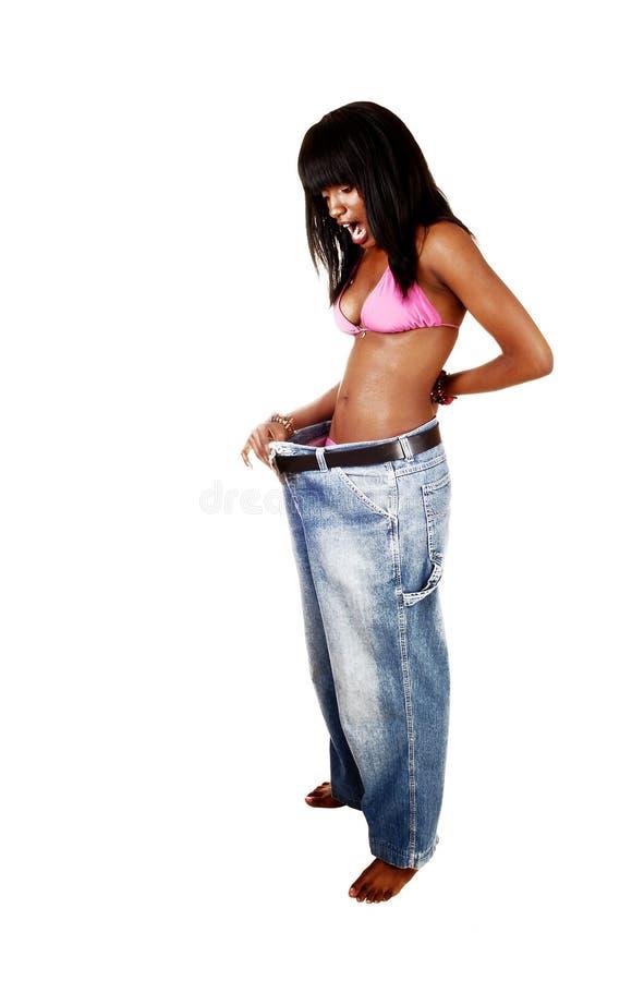 Flicka lossad vikt. arkivfoton