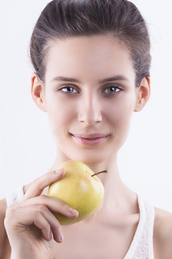 Download Flicka med äpplet fotografering för bildbyråer. Bild av banta - 37345593