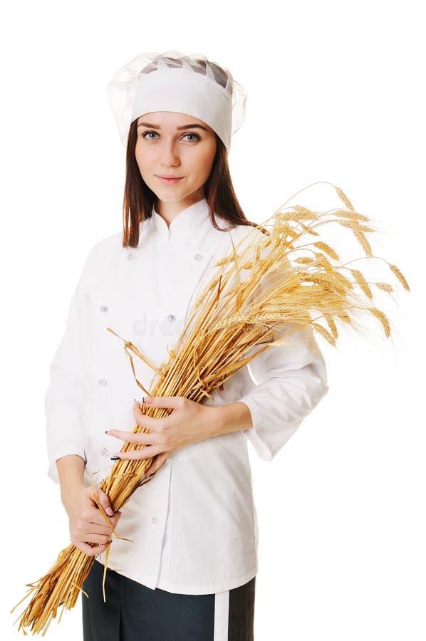 Flicka med öron av vete på en vit bakgrund arkivfoto
