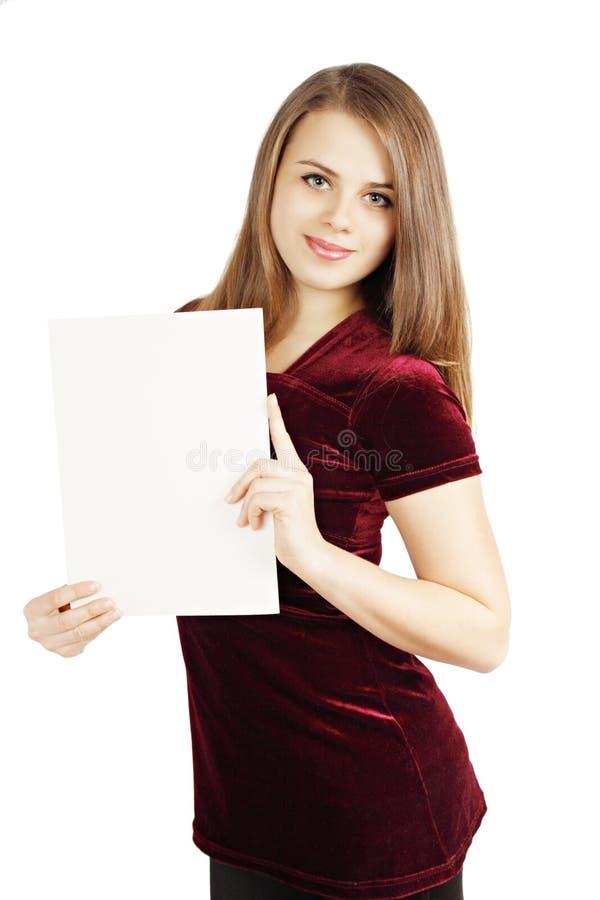 Flicka med arket av papper fotografering för bildbyråer