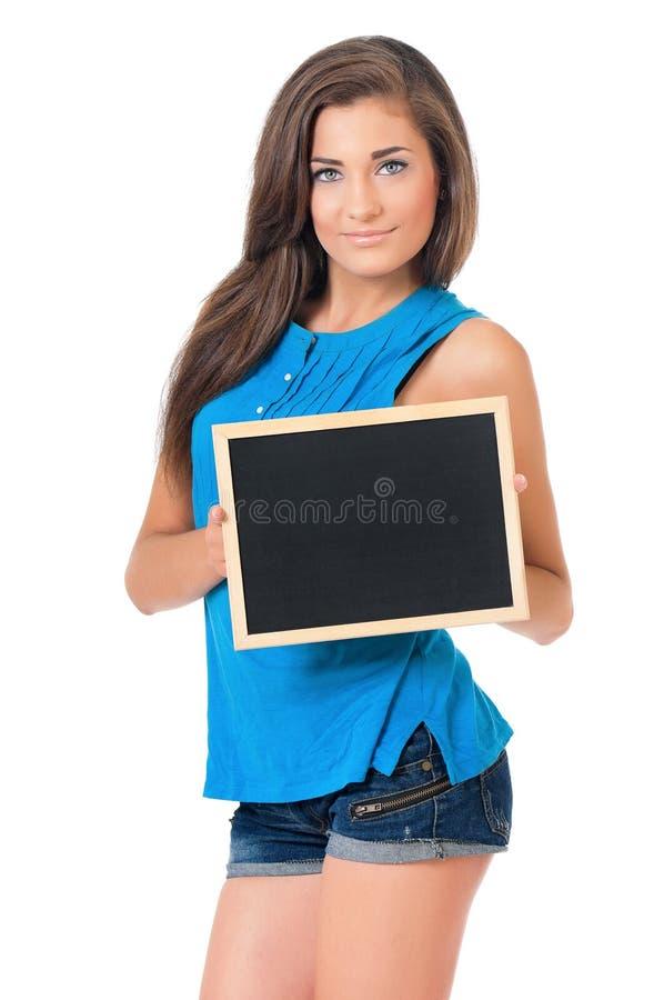 Flicka med blackboarden royaltyfri foto
