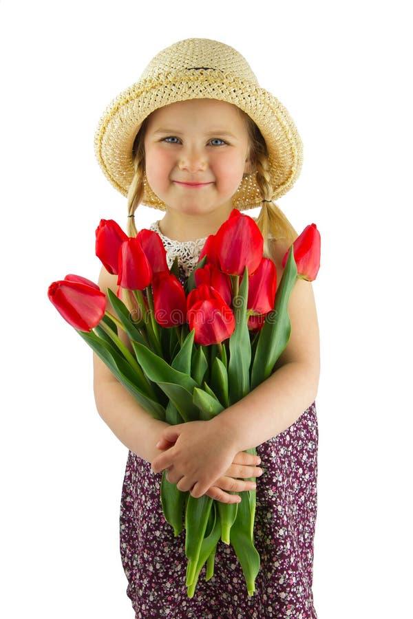 Flicka med blommor royaltyfria foton