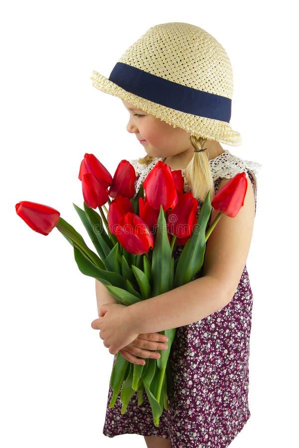 Flicka med blommor arkivfoto
