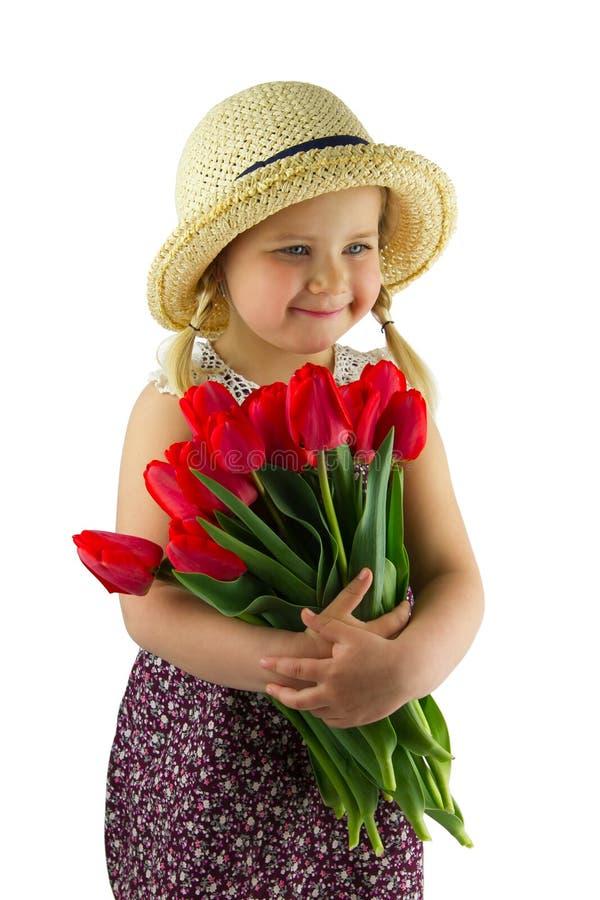 Flicka med blommor fotografering för bildbyråer