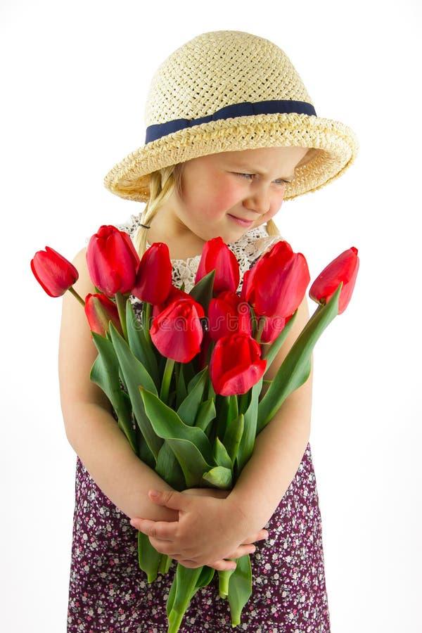 Flicka med blommor arkivbild