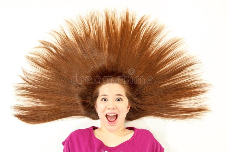 Flicka med broddat hår fotografering för bildbyråer